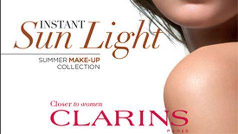 Instant Sun Light  Clarins