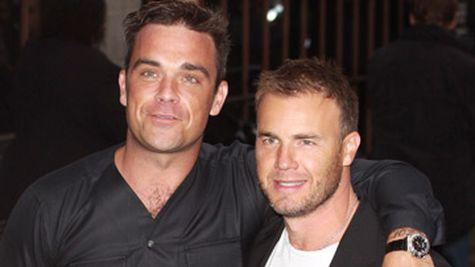 Robbie Williams pe scena cu Gary Barlow