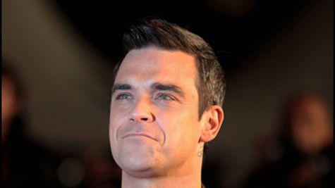 Robbie Williams isi doreste copii gay